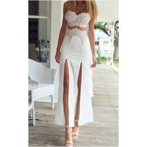 Long white lace dress with slits on the front.